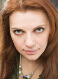 Young red-haired woman Royalty Free Stock Images