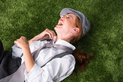 Young red-haired woman as a man dressed in the garden Stock Photos
