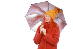 Young red haired woman in casual outfit with umbrella. Smiling over white background Royalty Free Stock Image