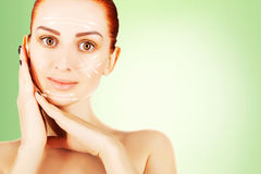 Young red haired woman closeup with surgery lines, green gradien Stock Photos