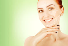 Young red haired woman closeup with surgery lines, green gradien Stock Photography