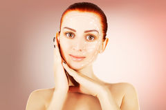 Young red haired woman closeup with surgery lines, pink gradient Royalty Free Stock Image