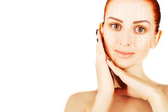 Young red haired woman closeup with surgery lines, white  backgr Stock Photography