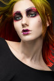 Young red-haired woman with colorful make up. Isolated studio portrait Royalty Free Stock Photography