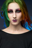 Young red-haired woman with colorful make up. Studio portrait Stock Photo