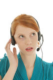 Young red haired woman with head set Stock Photography