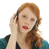 Young red haired woman with head set Royalty Free Stock Image
