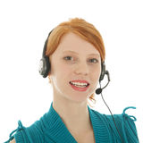 Young red haired woman with head set Royalty Free Stock Photography