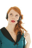 Young red haired woman with head set Royalty Free Stock Photos