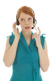 Young red haired woman with head set Stock Images