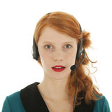 Young red haired woman with head set Stock Image
