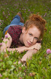 Young red haired woman in the meadow Royalty Free Stock Photo