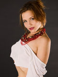 Young red-haired woman with necklace by side. Young red-haired woman by side with naked shoulder Stock Image