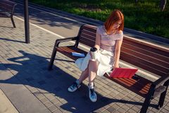 A young red-haired woman in park royalty free stock photography