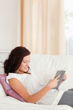 Young red-haired woman reading a book Royalty Free Stock Photography