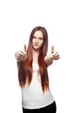 Young red-haired woman showing thumb-up Royalty Free Stock Photography