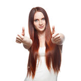 Young red-haired woman showing thumb-up Stock Photography