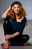 Young red-haired woman sitting on the floor Royalty Free Stock Photo