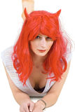 Young red haired woman in a wig and lingerie Royalty Free Stock Photo