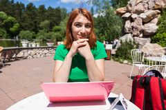 A young red-haired woman stock images