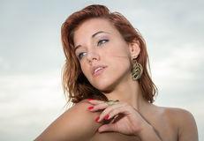 Young red head woman looking away Stock Photography