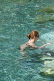 Young red headed woman in  bikini Royalty Free Stock Image