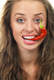 Young with red hot chilli pepper Royalty Free Stock Photos