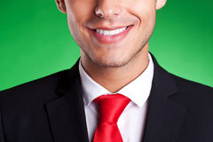 A young red tie business man smiling Royalty Free Stock Photos