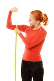 Young red woman with measuring tape Royalty Free Stock Image