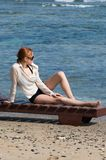 Young red woman sunbathing Royalty Free Stock Image
