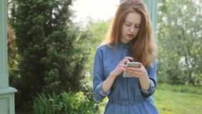 Young redhair woman use mobile phone shopping online and pay with internet banking.  stock video