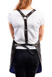 Young redhaired woman chef or waiter posing, wearing apron and t-shirt isolated on white background. Royalty Free Stock Images