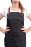 Young redhaired woman chef or waiter posing, wearing apron and t-shirt isolated on white background. Stock Images