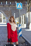 Young redhaired woman crossing the street stock image