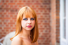 Young redhaired woman. Redhaired girl with bright blue eyes Stock Photos