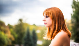 Young redhaired woman. Profile of a young redhaired womans face Royalty Free Stock Images
