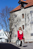 Young redhaired woman walking in medieval european town Royalty Free Stock Photos