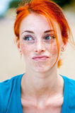 Young redhead beautiful freckled woman thinking Royalty Free Stock Photography