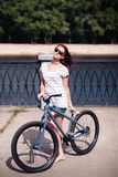 Young redhead biker girl Royalty Free Stock Photos
