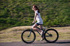 Young redhead biker girl Stock Images