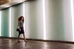 Young redhead business woman walking to work Stock Image