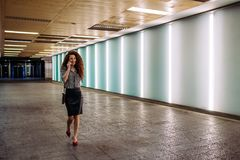 Young redhead business woman walking to work stock images