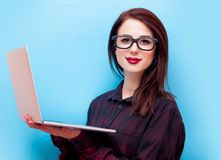 Young redhead businesswoman holding laptop computer Royalty Free Stock Image