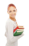 A young redhead Caucasian woman holding books Royalty Free Stock Photo