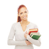 A young redhead Caucasian woman holding books Stock Image