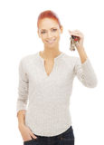 A young redhead Caucasian woman holding keys Stock Photos