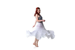 Young redhead dancer in ethnic costume Royalty Free Stock Image