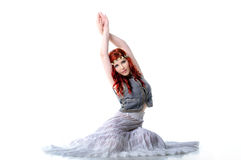 Young redhead dancer in ethnic costume Royalty Free Stock Photos