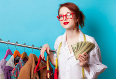 Young redhead designer with dollars Stock Photography