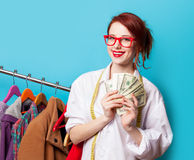 Young redhead designer with dollars Royalty Free Stock Photography